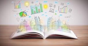Disegno di uno schema di affari su un libro aperto Fotografie Stock