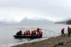 Disembarkation of tourists from the cruise ship to the Aguila glacier in southern Patagonia. TIERRA DEL FUEGO, CHILE - NOVEMBER 20,2014:Disembarkation of Royalty Free Stock Photos