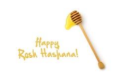 Diseño judío de la tarjeta de felicitación del día de fiesta del Año Nuevo con el palillo de madera de la miel Foto de archivo libre de regalías