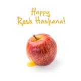 Diseño judío de la tarjeta de felicitación del día de fiesta del Año Nuevo con la manzana y la miel en el fondo blanco Fotos de archivo