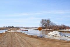 Disgelo della primavera sopra una strada Fotografia Stock Libera da Diritti
