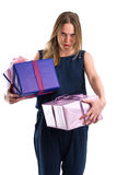 Disgruntled looking woman carrying heavy gift packages Royalty Free Stock Images