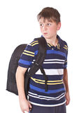 Disgruntled student with a school backpack stock image