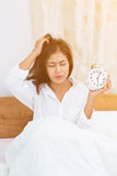Disgruntled woman waking up Royalty Free Stock Photography