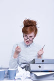 Disgruntled worker behind the desk Royalty Free Stock Photos