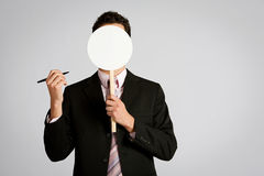 Disguise: Businessman With Empty Mask Royalty Free Stock Images