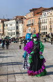 Disguised Couple. Venice, Italy- February 18th, 2012: Two disguised people posing in Sestiere Castelo during the Venice Carnival days Stock Image