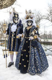Disguised Couple. Annecy, France, February 23, 2013: Couple disguised in beautiful costumes posing near a canal in Annecy, France,  during a Venetian Carnival Stock Images