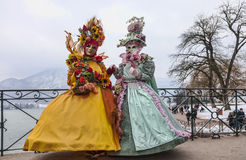 Disguised Couple in Annecy. Annecy, France, February 23, 2013: Couple disguised in beautiful costumes posing on the Lovers Bridge over a canal canal in Annecy Stock Images