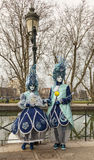 Disguised Couple. Annecy,France-March 15,2014:Unidentified disguised couple posing near a canal during the Annecy Venetian Carnival. Yearly in Annecy ,France is Stock Image