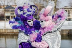 Disguised Couple - Annecy Venetian Carnival 2013. Annecy, France, February 24, 2013: A disguised couple posing in Annecy, France, during a Venetian Carnival Royalty Free Stock Images