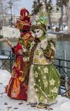 Disguised Couple - Annecy Venetian Carnival 2013. Annecy, France, February 24, 2013: A disguised couple posing in Annecy, France, during a Venetian Carnival Stock Photos