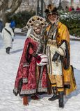 Disguised Couple - Annecy Venetian Carnival 2013. Annecy, France, February 24, 2013: A disguised couple posing in Annecy, France, during a Venetian Carnival Stock Photography