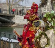 Disguised Couple - Annecy Venetian Carnival 2013. Annecy, France, February 24, 2013: A disguised couple posing in Annecy, France, during a Venetian Carnival Royalty Free Stock Image