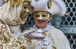 Disguised Couple with Magic Ball Royalty Free Stock Photography