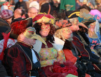 Disguised people. Venice,Italy-February 26th, 2011: Image of a group of disugised people on a terrace on Sestiere Castello in Venice during the Carnival days.The Royalty Free Stock Photography