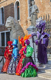 Disguised People. Venice, Italy- February 18th, 2012: A group of disguised people posing in front of traditional buildings during the Venice Carnival days Stock Image