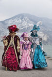 Disguised People in Annecy. Annecy, France- February 23, 2013: A group of three people disguised in beautiful costumes walking together near the Annecy Lake Royalty Free Stock Photography
