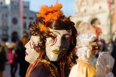 Disguised people at the Carnival of Venice. Venice, Italy - February 25, 2017: unidentified disguised people at the Carnival of Venice. The Carnival of Venice is Stock Photography