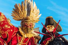 Disguised people at the Carnival of Venice. Venice, Italy - February 25, 2017: unidentified disguised people at the Carnival of Venice. The Carnival of Venice is Royalty Free Stock Photos