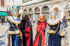 Disguised people at the Carnival of Venice. Venice, Italy - February 26, 2017: unidentified disguised people at the Carnival of Venice. The Carnival of Venice is Stock Photo