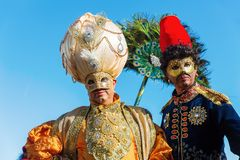 Disguised people at the Carnival of Venice. Venice, Italy - February 25, 2017: unidentified disguised people at the Carnival of Venice. The Carnival of Venice is Royalty Free Stock Photography