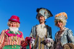 Disguised people at the Carnival of Venice. Venice, Italy - February 25, 2017: unidentified disguised people at the Carnival of Venice. The Carnival of Venice is Royalty Free Stock Photo
