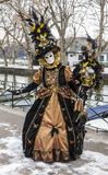 Disguised Person. Annecy, France, February 23, 2013:Unidentified person disguised in a beautiful costume posing near a canal in Annecy, France, during a Venetian Stock Photography