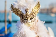 Disguised person at the Carnival of Venice. Venice, Italy - February 26, 2017: unidentified disguised person at the Carnival of Venice. The Carnival of Venice is Royalty Free Stock Photography