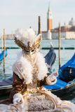 Disguised person at the Carnival of Venice. Venice, Italy - February 26, 2017: unidentified disguised person at the Carnival of Venice. The Carnival of Venice is Stock Photography
