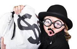 Disguised Woman Holding Moneybag Royalty Free Stock Photo