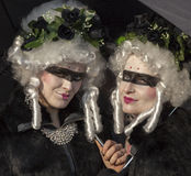 Disguised Women. Venice, Italy-February 18,2012: Portrait of a two women disguised during the Venice Carnival days Royalty Free Stock Photos