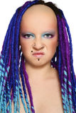 Disgust. Portrait of stylish freaky girl with blue dreads and disgust expression Stock Photography