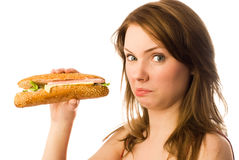 Disgust. Beautiful young woman shows her disgust to fast food Stock Photo