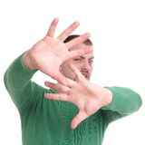 Disgust. Ed young man with raised hands Royalty Free Stock Photography