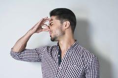 Disgusted запах Стоковая Фотография