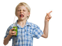 Disgusted boy with green smoothie pointing Stock Photography