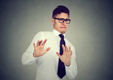 Disgusted business man isolated on gray background royalty free stock photography