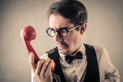 Disgusted businessman at the phone stock photos