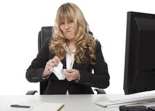 Disgusted businesswoman ripping up paper Stock Photo