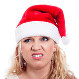 Disgusted Christmas woman face Stock Image