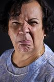 Disgusted expression. This is a old woman's portrait showing a disgusted expression Royalty Free Stock Image