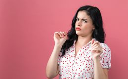 Disgusted face expression with young woman royalty free stock images
