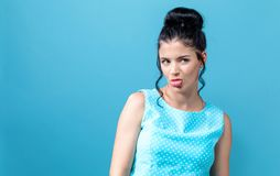 Disgusted face expression with young woman. On a solid background royalty free stock photo