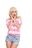 Disgusted girl. Blonde young woman looking disgusted holding head in hands. Three quarter length studio shot isolated on white royalty free stock images