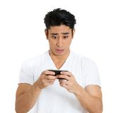 Disgusted man with phone Royalty Free Stock Image