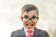 Disgusted. Smartly dressed young boy with a disgusted look on his face royalty free stock photo
