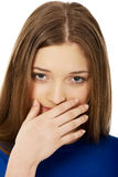Disgusted teen covering her mouth. Stock Images