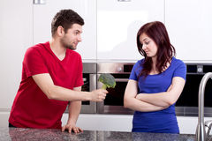Disgusted wife standing in kitchen Royalty Free Stock Photography