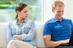 Disgusted woman and addicted man Stock Image